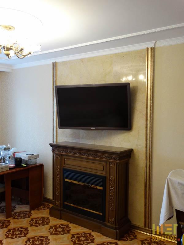 электрокамин и телевизор в гостиной